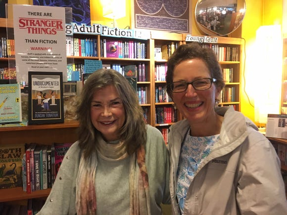 Author Delia Owens meets with her friend, Leslie Anne Keller, of Asheville, before her talk at Malaprop's Bookstore May 8.