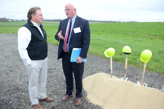 Peter Bowers, left, president of Waco, talks about the new expansion with Battle Creek Mayor Mark Behnke.