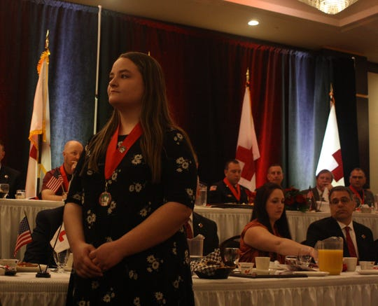 Trinity Howe receives the Good Samaritan Youth Award during the American Red Cross of the Southern Tier's Real Heroes Breakfast Thursday morning. She saved her family from a fire in November.