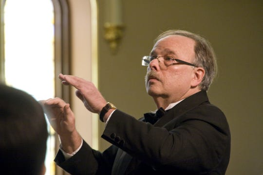 Bruce Borton is the conductor of the Madrigal Choir of Binghamton.