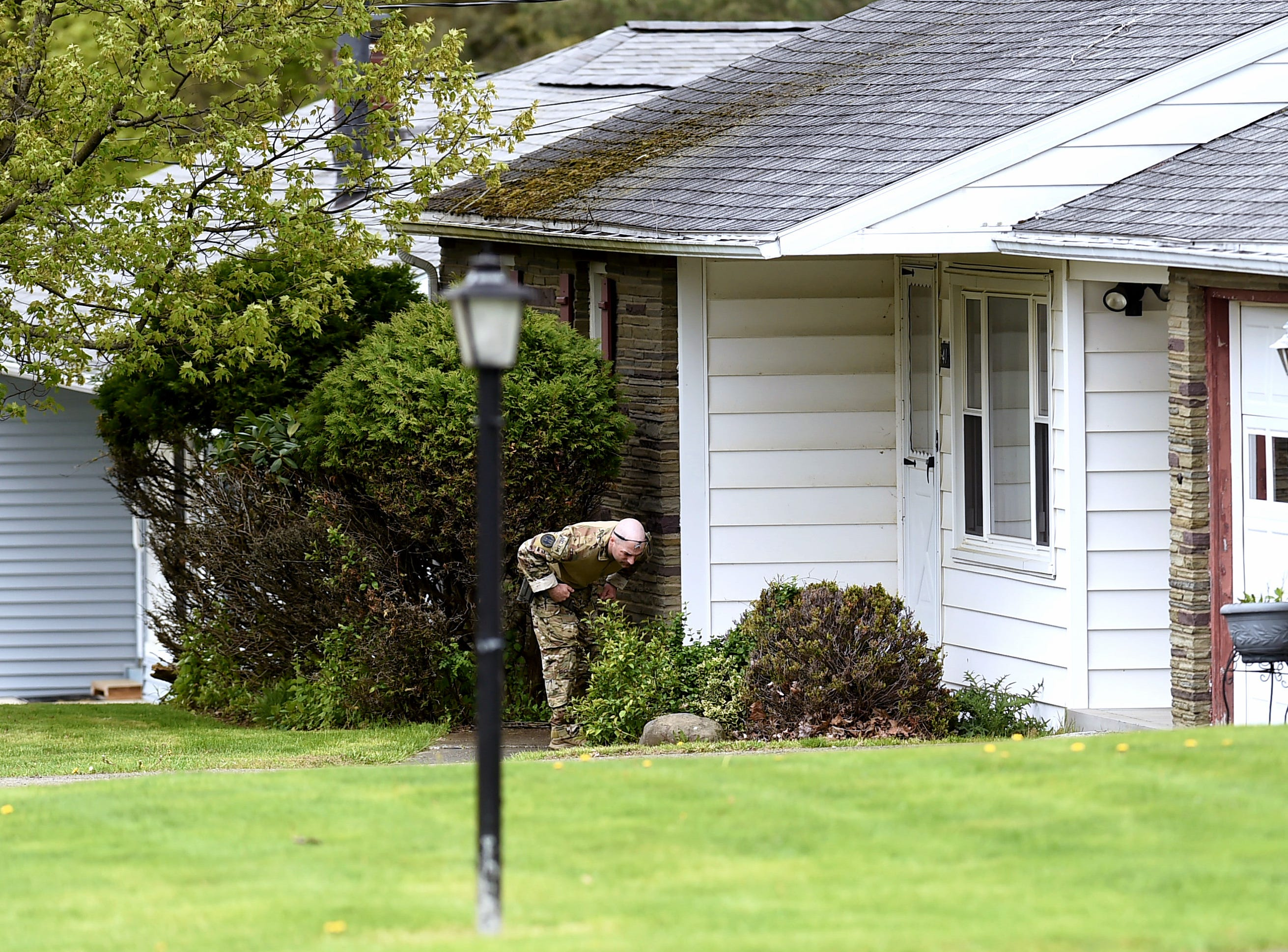 Investigators search the neighborhood near the scene of Apalachin home invasion and homicide which occurred in the early morning hours of Thursday, May 9, 2019.