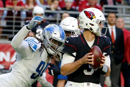 In this Sunday, Dec. 9, 2018, file photo, Detroit Lions defensive end Ezekiel Ansah, left, rushes Arizona Cardinals quarterback Josh Rosen (3) during an NFL football game, in Glendale, Ariz. The Seattle Seahawks are addressing one of their biggest offseason needs as veteran defensive end Ansah has agreed to a one-year deal with the team, according to a person with knowledge of the deal, Wednesday, May 8, 2019.