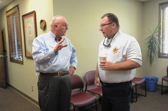 Black Mountain alderman Larry Harris, left, welcome fire chief Scottie Harris (no relation) during a meet and greet at town hall of May 9.