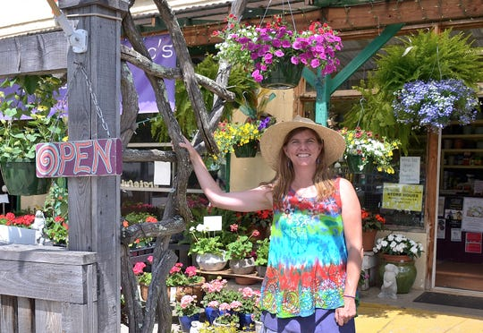 Mellie Macsherry stands in front of Mellie Mac's Garden Shack in Black Mountain.