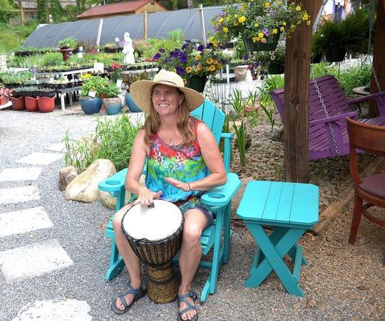 Mellie Macsherry plays a drum at her Black Mountain nursery Mellie Mac's Garden Shack.