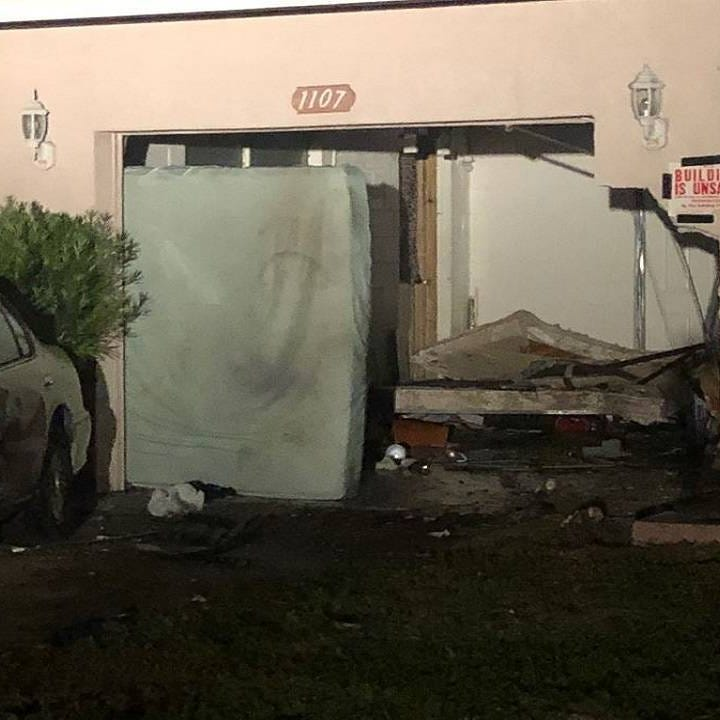 Cocoa police alerted to stolen sheriff's SUV chasing cars before one crashes into home