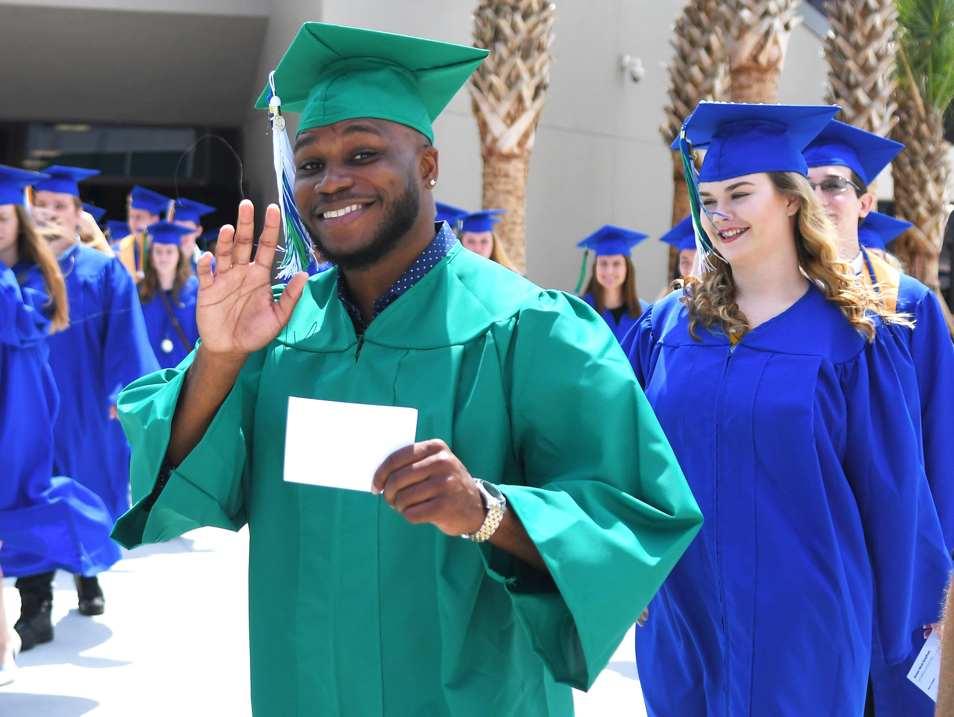 EFSC's 1,000th Bachelor's degree graduate is Derick Pierre. Graduates at the noon Eastern Florida State College 2019 Spring Commencement at the Melbourne campus. An additional commencement was held at 3:00 p.m.