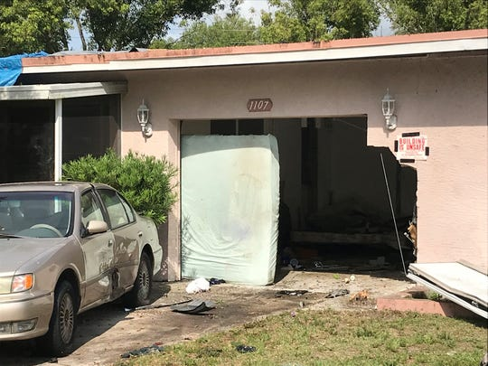 A stolen Orange County Sheriff's Office vehicle reportedly chased several cars in Brevard County Wednesday night, causing one to crash into a Cocoa home.
