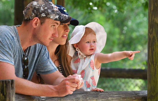 Atlanta residents Steve and Ashton Lindberg, and their daughter, Belle, who is 21 months old, were among the visitors to the Brevard Zoo in Viera on Thursday.