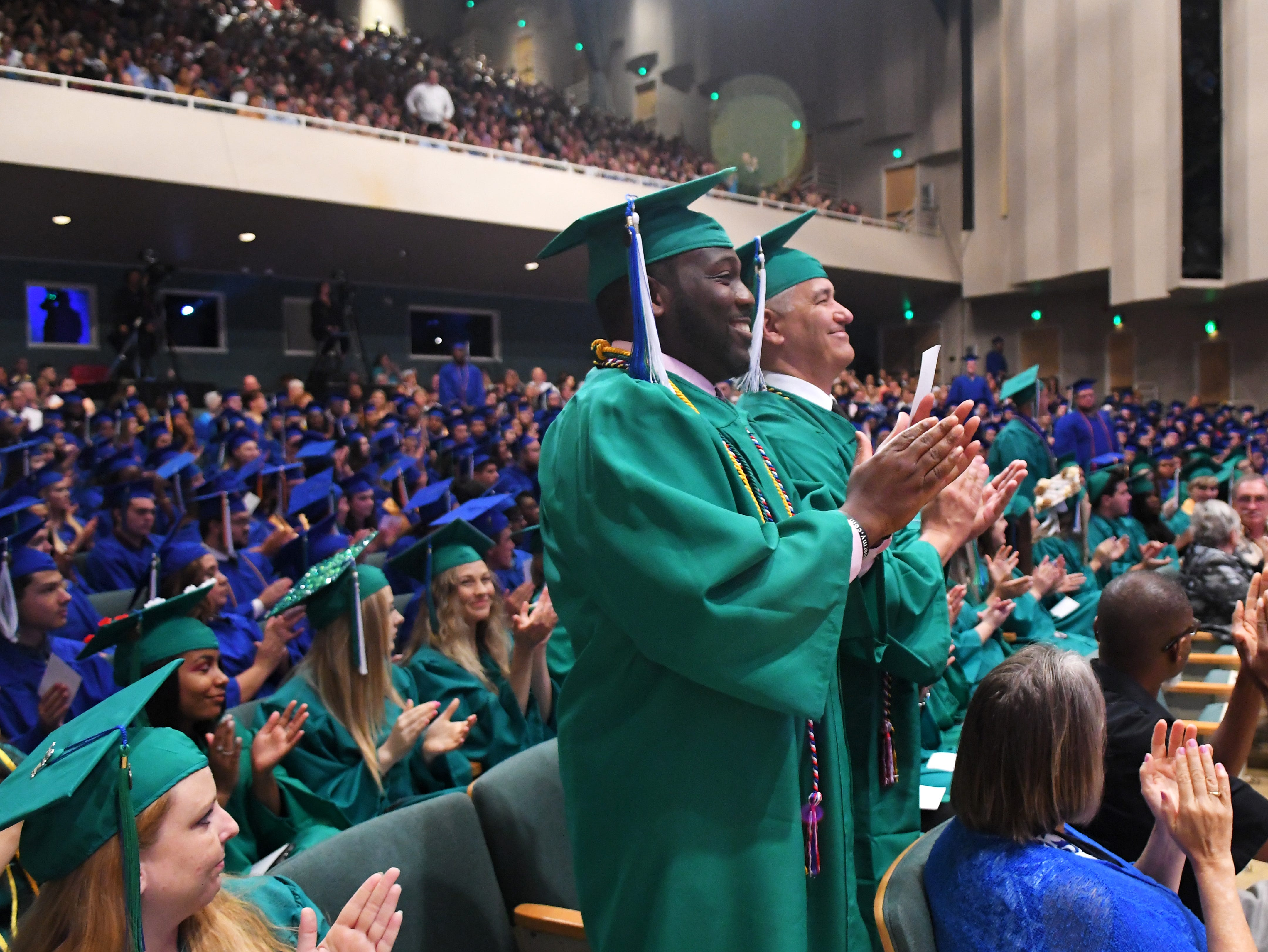 Graduates who have served in the military were asked to stand, to the applause of the crowd. Graduates at the noon Eastern Florida State College 2019 Spring Commencement at the Melbourne campus. An additional commencement was held at 3:00 p.m.