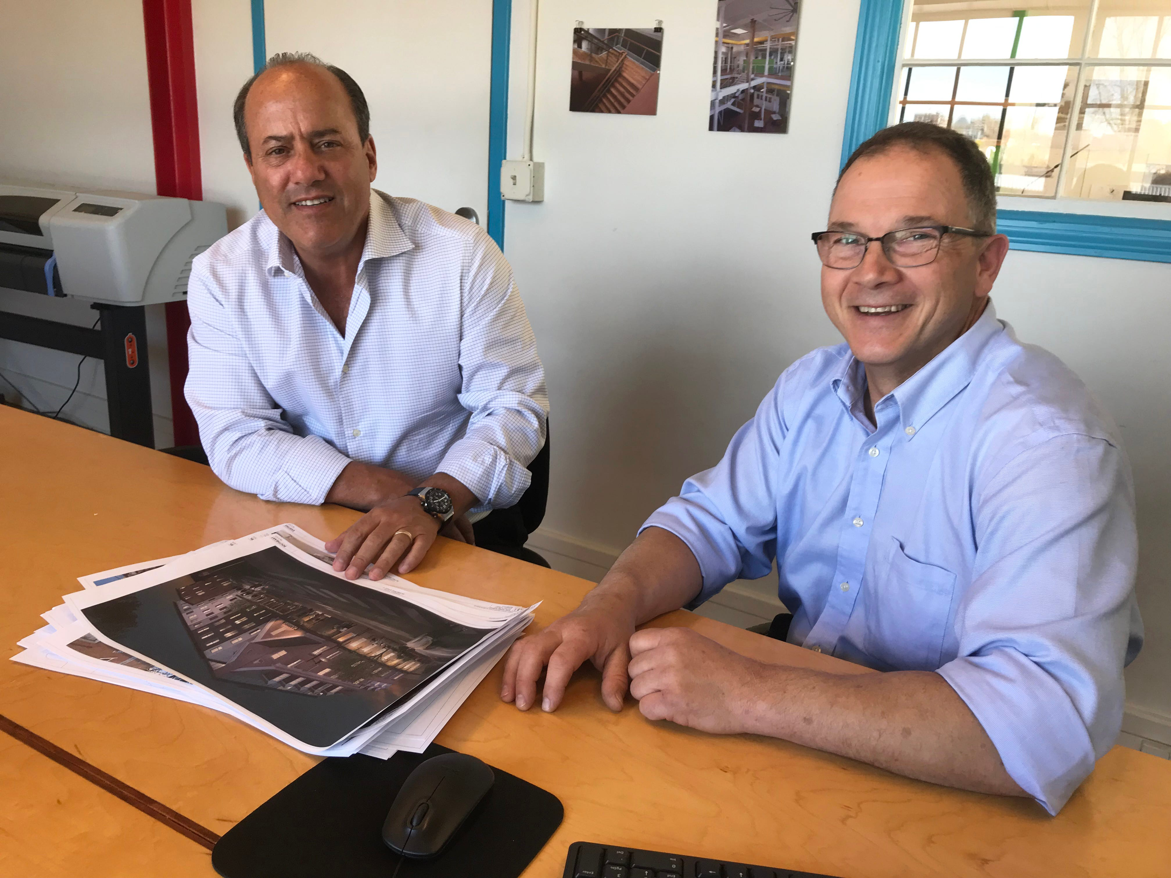 Burlington architect Cleary Buckley, right, discusses designs for a proposed hotel with developer Scott Silver at Buckley's office on Pine Street on Wednesday, May 8, 2019.