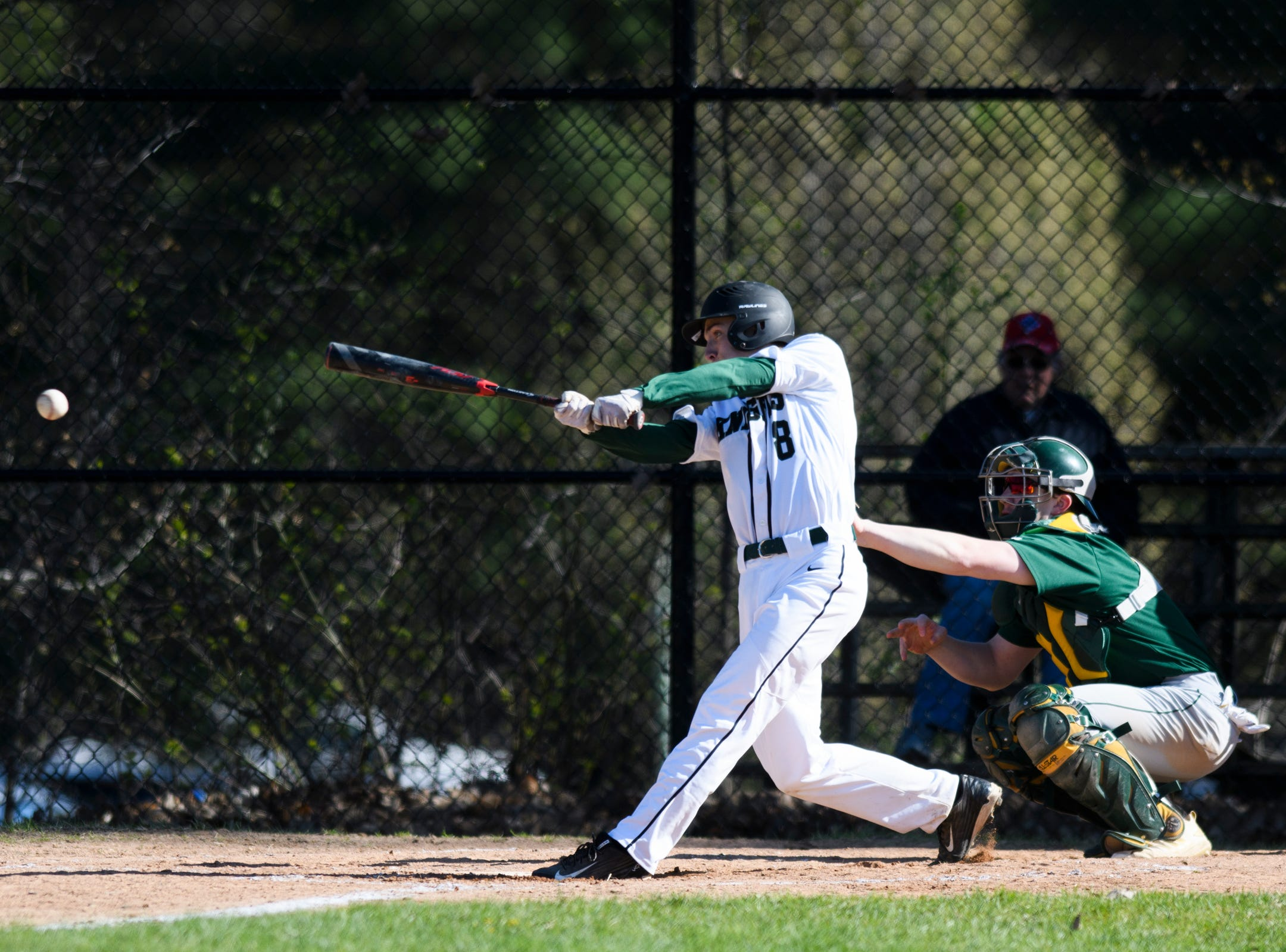 Rice's JB Bahrenburg (8) hits the ball during the high school baseball game between BFA St. Albans and Rice at Rice Memorial High School on Wednesday afternoon May 8, 2019 in South Burlington, Vermont.