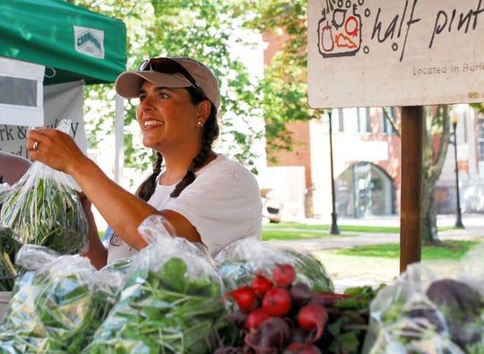 Mara Welton, owner of Half Pint Farm in Burlington's Intervale, at her farmstand at the Burlington Farmers Market in City Hall Park on Aug. 28, 2013.