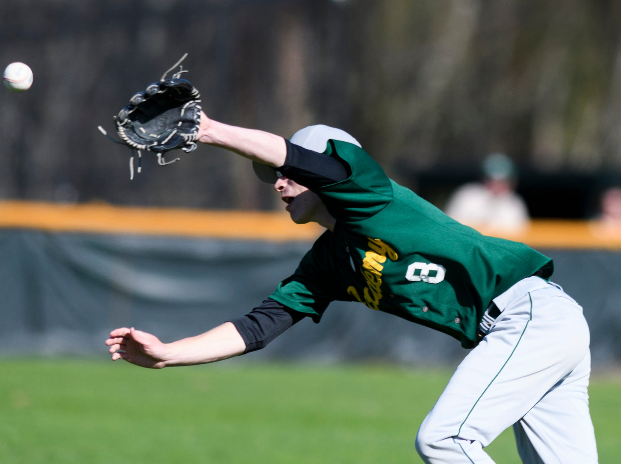 BFA's Jacob Beware (8) dives to try an catch the fly ball during the high school baseball game between BFA St. Albans and Rice at Rice Memorial High School on Wednesday afternoon May 8, 2019 in South Burlington, Vermont.