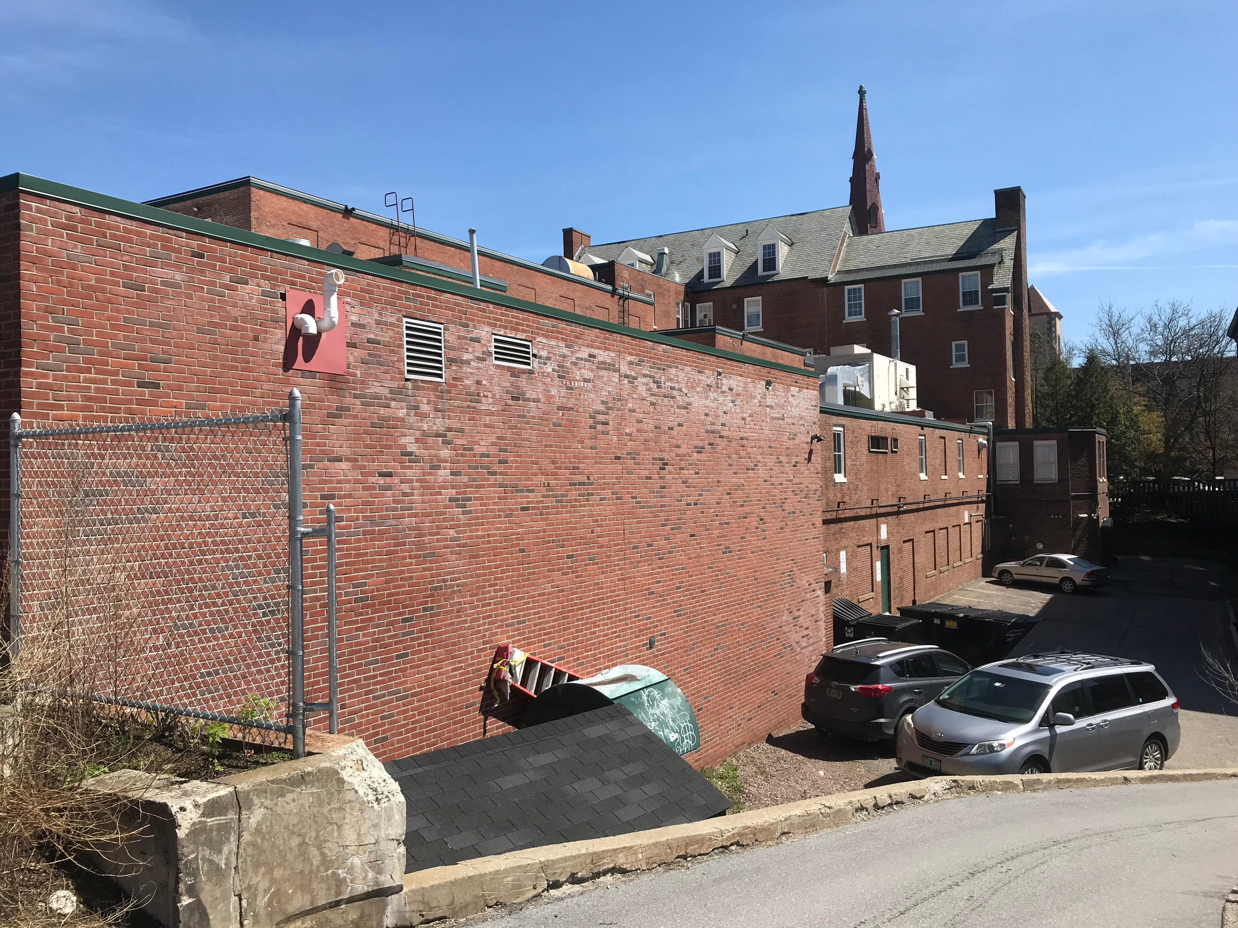 """The northernmost portions of the Burlington YMCA are seen in this view from the """"City Market"""" parking lot on May 8, 2019."""