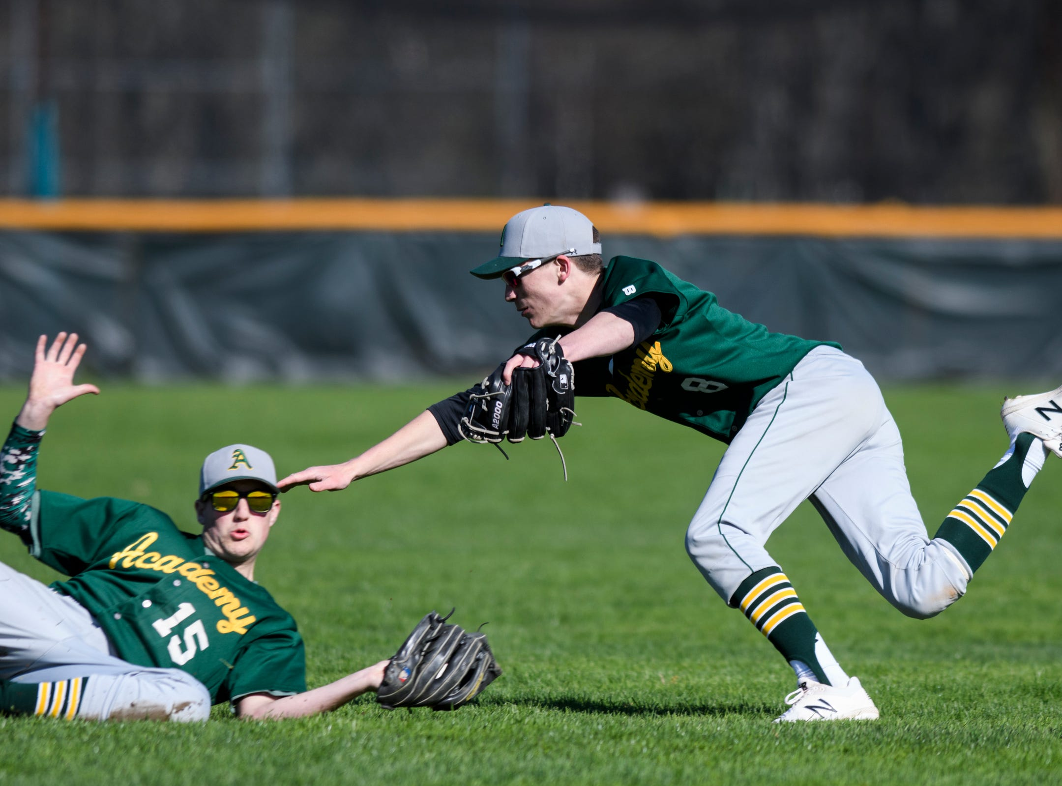 BFA's Shane Makes (15) dives to catch the ball in front of BFA's Jacob Beware (8) during the high school baseball game between BFA St. Albans and Rice at Rice Memorial High School on Wednesday afternoon May 8, 2019 in South Burlington, Vermont.