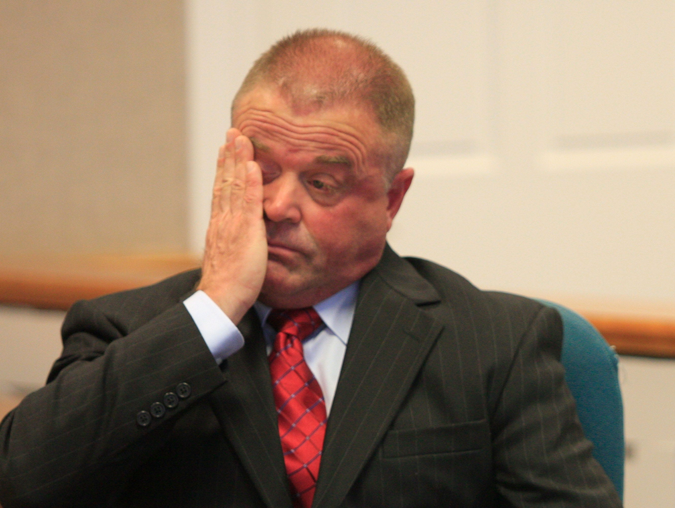 Former Vergennes, Vt., Police Chief Michael Lowe wipes away a tear during sentencing proceedings at Mahady Courthouse in Middlebury, Vt. on Wednesday, April 28, 2010. The former Vermont lawman who became so addicted to prescription drugs that he used underlings to illegally acquire them was sentenced Wednesday to six months in prison.