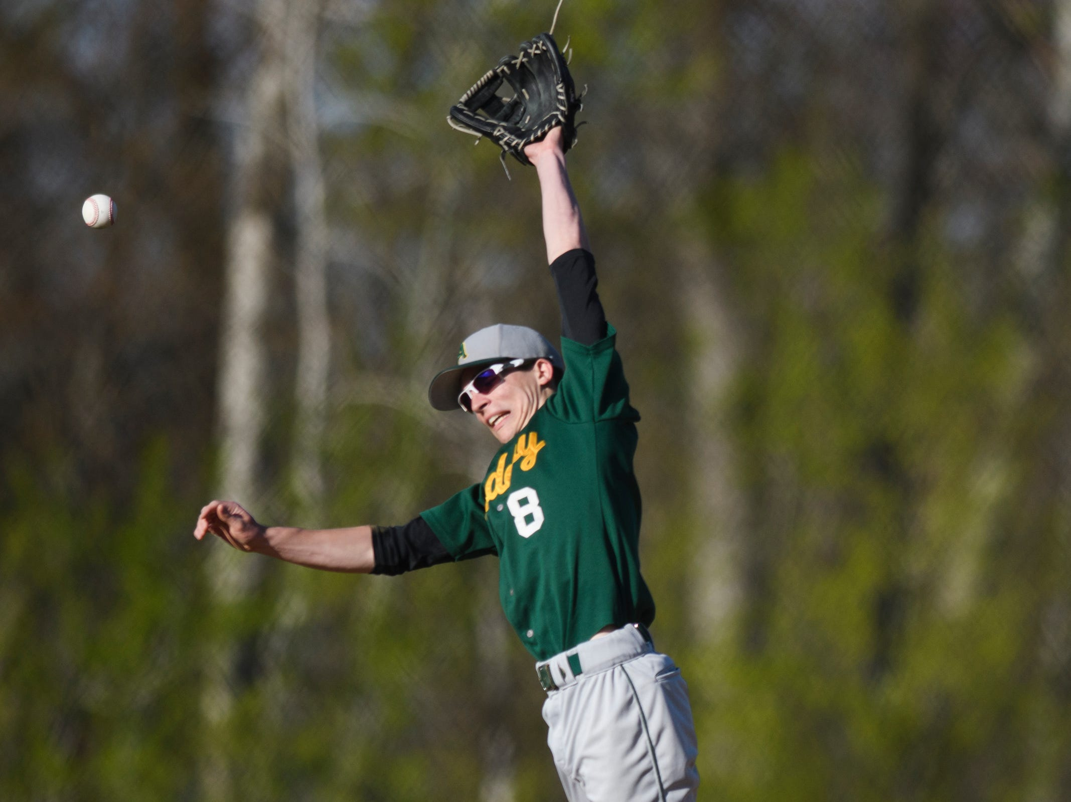 BFA's Jacob Beware (8) leaps to try and catch the ball during the high school baseball game between BFA St. Albans and Rice at Rice Memorial High School on Wednesday afternoon May 8, 2019 in South Burlington, Vermont.