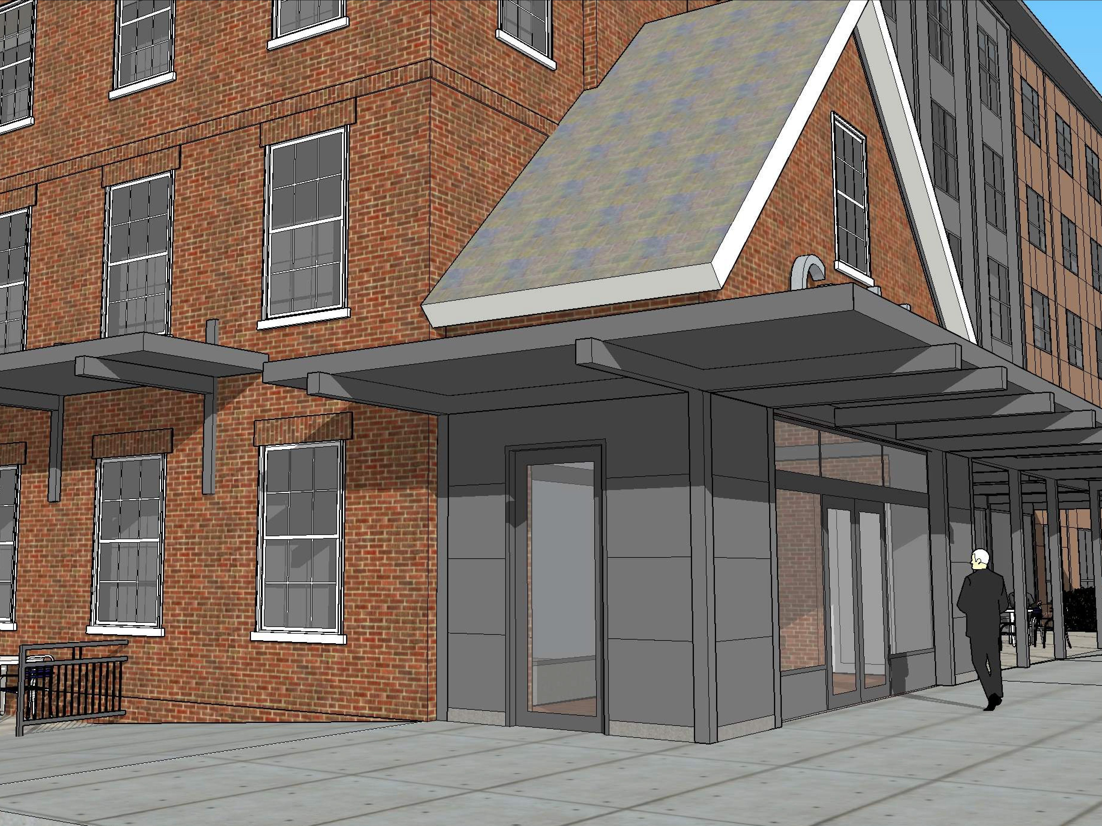 Detailed street view, from the southeast: The entrance to the proposed Cambria Hotel at the old YMCA property in downtown Burlington is seen in this rendering created in March 2019 by Smith Buckley Architects.