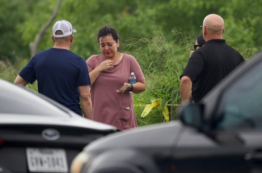 Teri Rios, the mother of missing TAMUCC student Brandon Rios, waits as police investigate the discovery of a body near Oso Bay on Thursday, May 9, 2019.