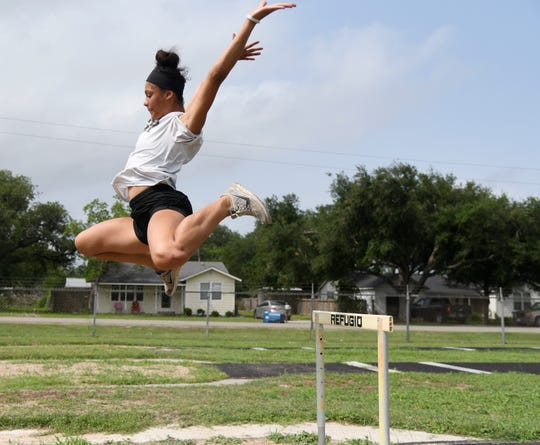 Tracelyn Ross practices long jump, Wednesday, May 8, 2019, in Refugio.