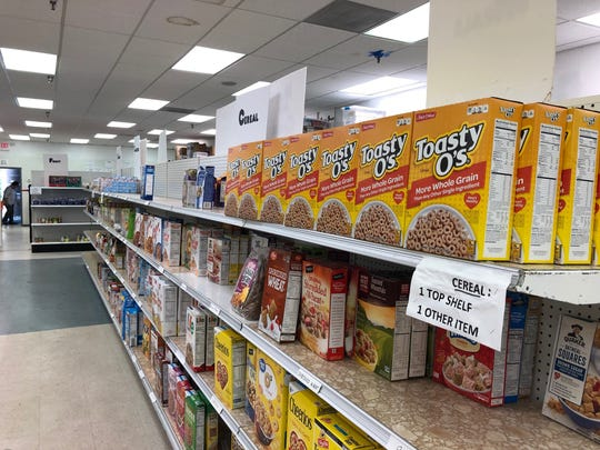 Clients of the Cherry Hill Food Pantry can fill their bags with groceries including cereal, baked goods, dairy items, meat and produce. The food pantry has a limited time to find another space as the shopping center prepares for the arrival of an Asian market.