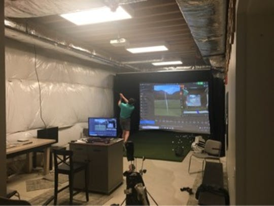 A golfer uses the TrackMan Indoor Golf Simulator for practice at the Moorestown Field Club. The simulator is in the basement of a new 2,500 square foot area that was expanded in the clubhouse.
