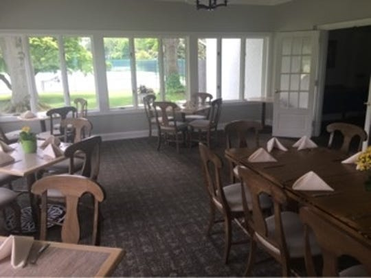This sunroom dining area at the Moorestown Field Club was renovated and is part of the improvements the club has made recently.