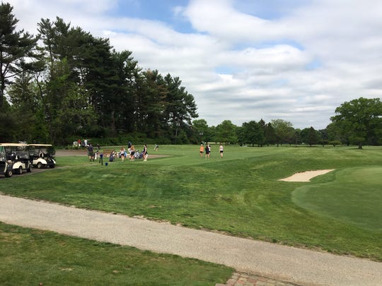Golfers enjoying the nine-hole golf course at Moorestown Field Club on a Wednesday afternoon. The club has done major upgrades, refurbishments and additions.