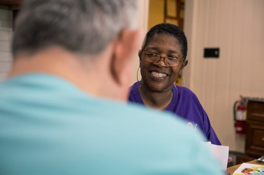Diane West, a direct service professional, right, works with her client Ed Barr at Earyestown Group Home in Lumberton, N.J. Thursday, May 9, 2019.