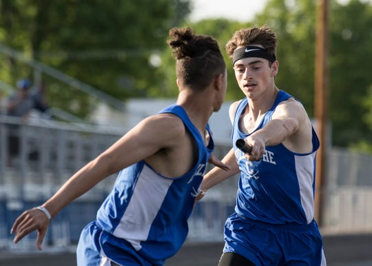 Chillicothe's Xzavier Doss hands off to Joey Wright in the boys 4x400 meter relay to create a new FAC league record time of 3:30.90 on May 8, 2019, in Chillicothe, Ohio.