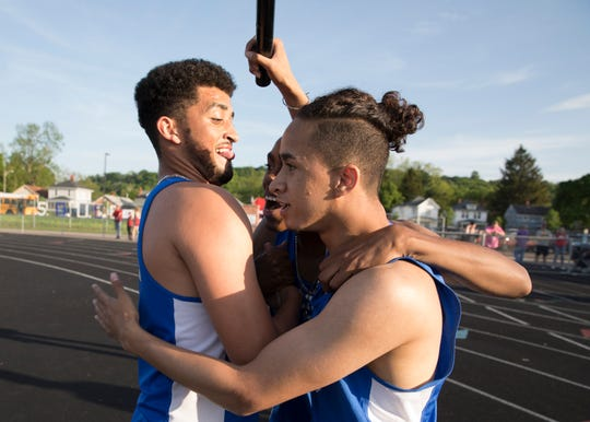 Members of Chillicothe's boys 4x400 meter relay team celebrate after finding out they broke the league record on May 8, 2019, in Chillicothe.