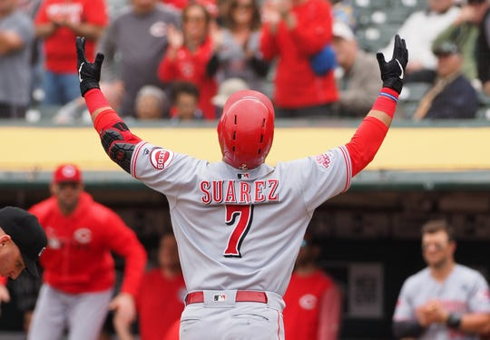 May 9, 2019; Oakland, CA, USA; Cincinnati Reds third baseman Eugenio Suarez (7) reacts at home plate after hitting a solo home run against the Oakland Athletics during the third inning at Oakland Coliseum. Mandatory Credit: Kelley L Cox-USA TODAY Sports