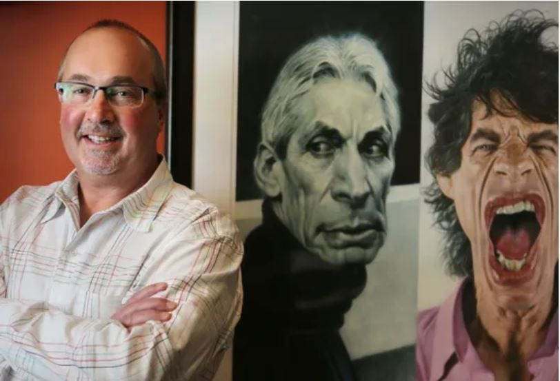Scott Stienecker, president and CEO of independent concert promoter AEG/PromoWest Productions, is photographed in his Columbus office alongside images of The Rolling Stones' drummer Charlie Watts, center, and lead singer Mick Jagger.