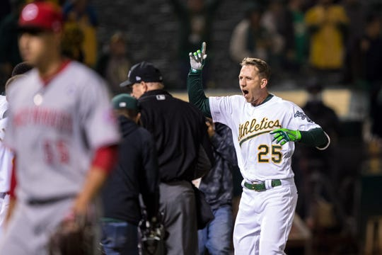 May 8, 2019; Oakland, CA, USA; Oakland Athletics right fielder Stephen Piscotty (25) celebrates after hitting a walk-off home run to end the game against the Cincinnati Reds in the thirteenth inning at Oakland Coliseum. Mandatory Credit: John Hefti-USA TODAY Sports