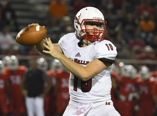 Lancer quarterback Drew Nieman attempts a pass against Colerain in the Skyline Chili Crosstown Showdown, Colerain Township, Friday August 24, 2018
