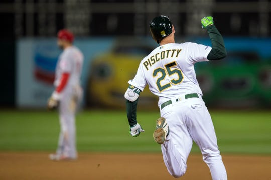 May 8, 2019; Oakland, CA, USA; Oakland Athletics right fielder Stephen Piscotty (25) hits a walk-off home run to end the game against the Cincinnati Reds in the thirteenth inning at Oakland Coliseum. Mandatory Credit: John Hefti-USA TODAY Sports