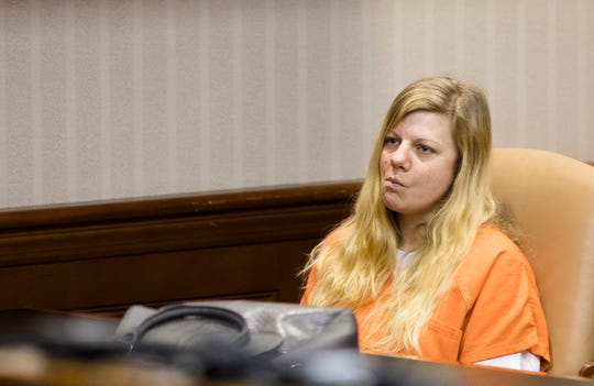 Lindsay Partin stands during her sentencing for the murder of a three-year-old, Hannah Wesche, on Thursday, May 9, 2019, in Hamilton, Ohio. Partin was sentenced to life in prison with the possibility of parol after 18 years.