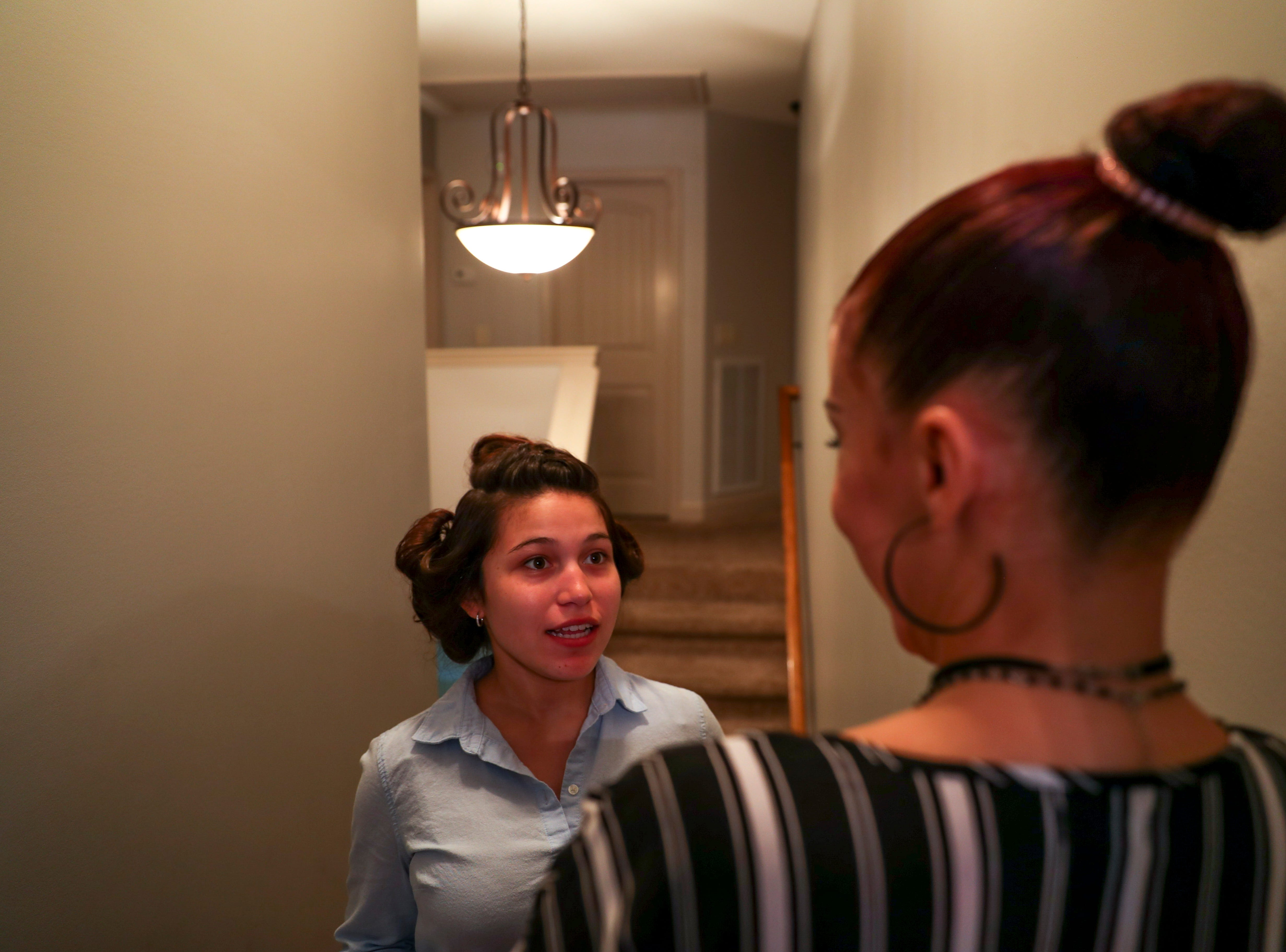 Dangela Gorrin, a senior attending prom at Northeast herself, talks to her mother about plans for another girl attending prom, Mia Lopez, at the Tejada household in Clarksville, Tenn., on Saturday, May 4, 2019.