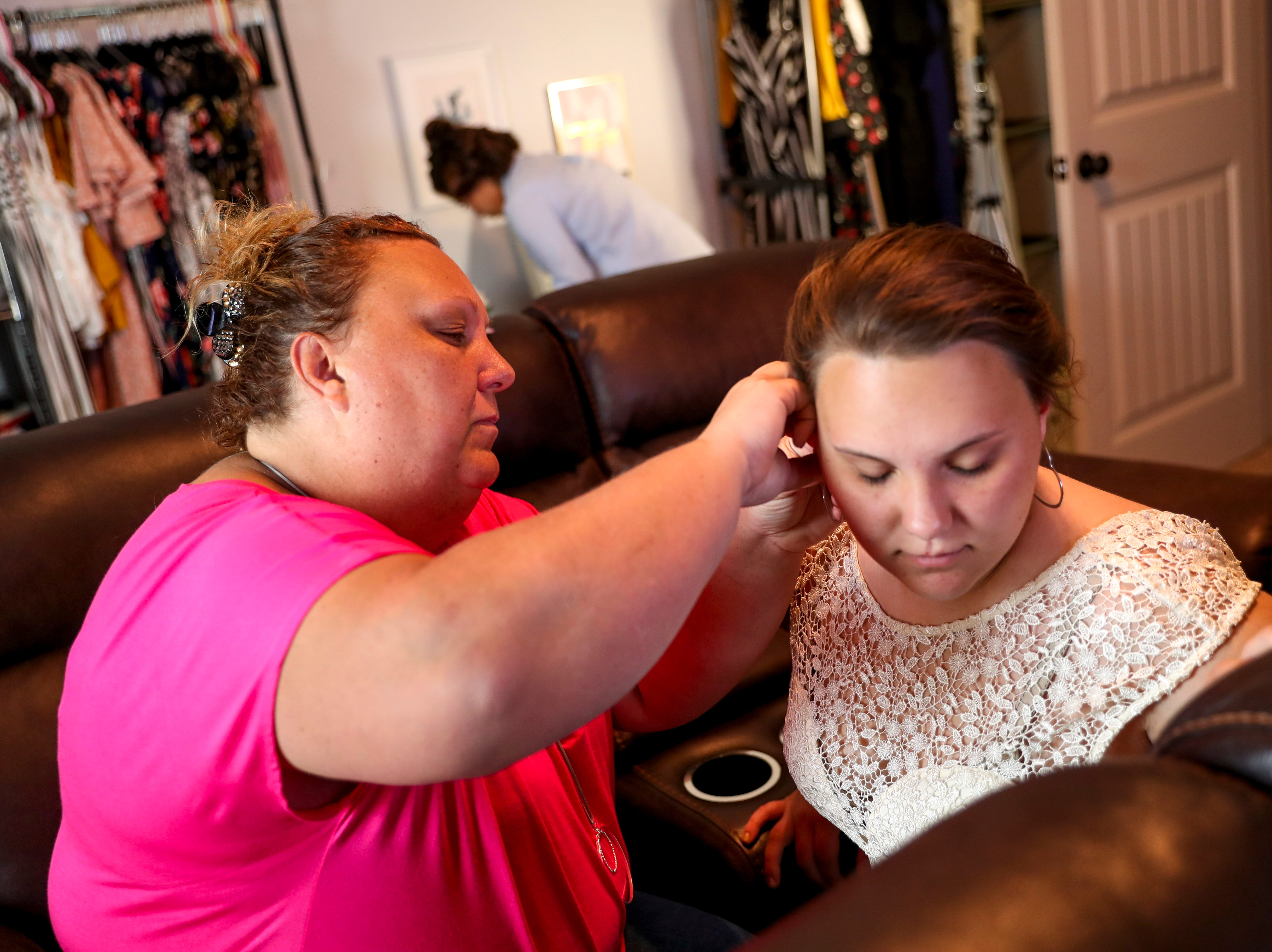 Amy Lopez sits down with her daughter Mia to put her earrings on at the Tejada household in Clarksville, Tenn., on Saturday, May 4, 2019.