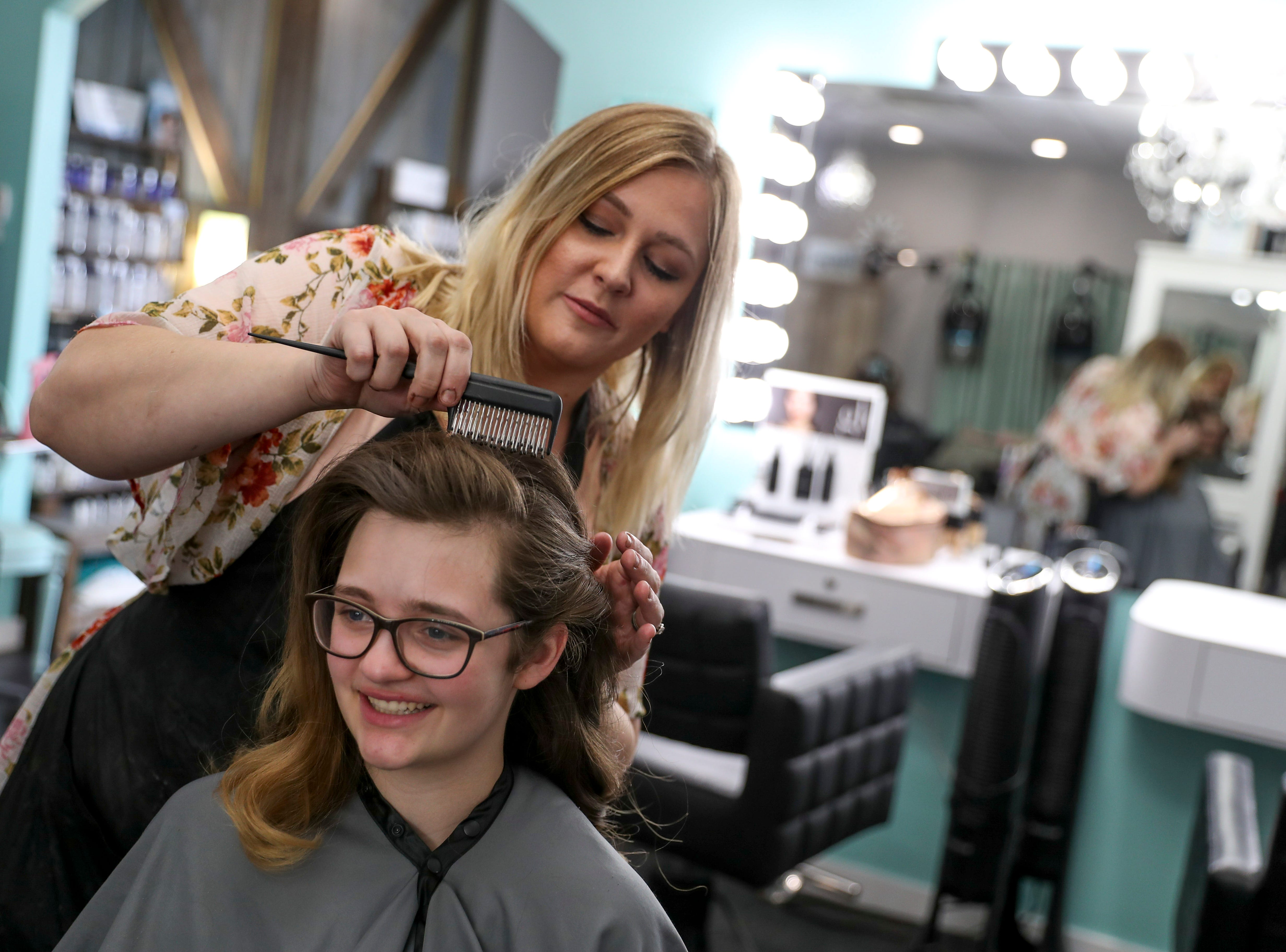 Christina West works on Madison Russell's hair to give her a retro look in the time before prom for Northeast High School at Tiffany's Hair Spa in Clarksville, Tenn., on Saturday, May 4, 2019.