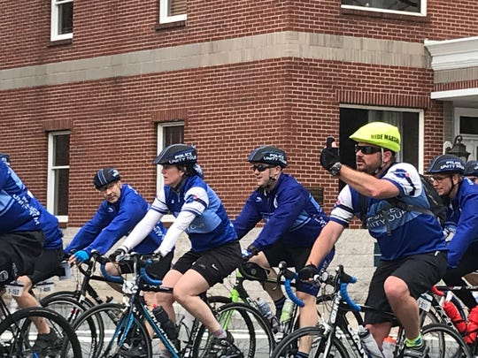 A group of riders traveling through Somerville as part of the Police Unity Tour