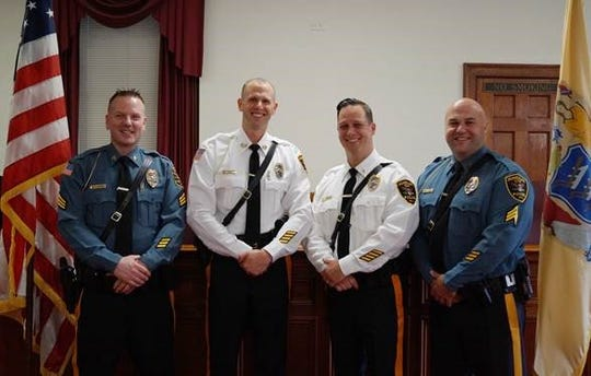 Dunellen Sgt. Brian Robbins, Police Chief Daniel Smith, Lt Christopher Beenders and Sgt. Christopher Lovell.