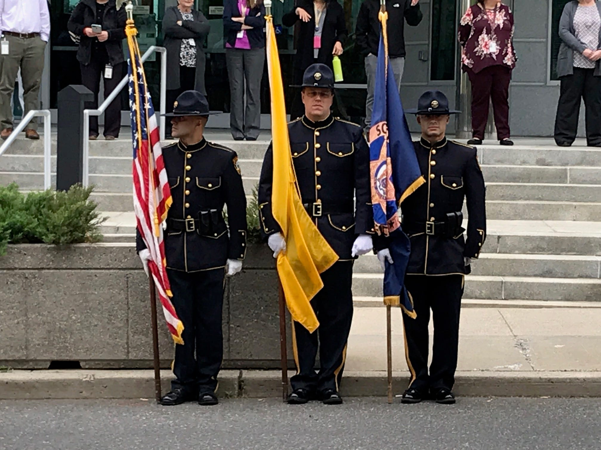 The honor guard in front of the Union County Administration Building prepare for the Police Unity Tour to travel through Somerville.