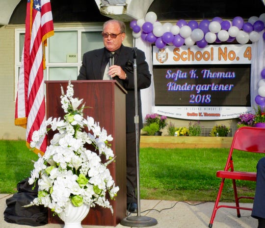 School No. 4 Principal Anthony Cataline speaking at a ceremony to dedicate a new electronic display board in memory of kindergartner Sofia Thomas.