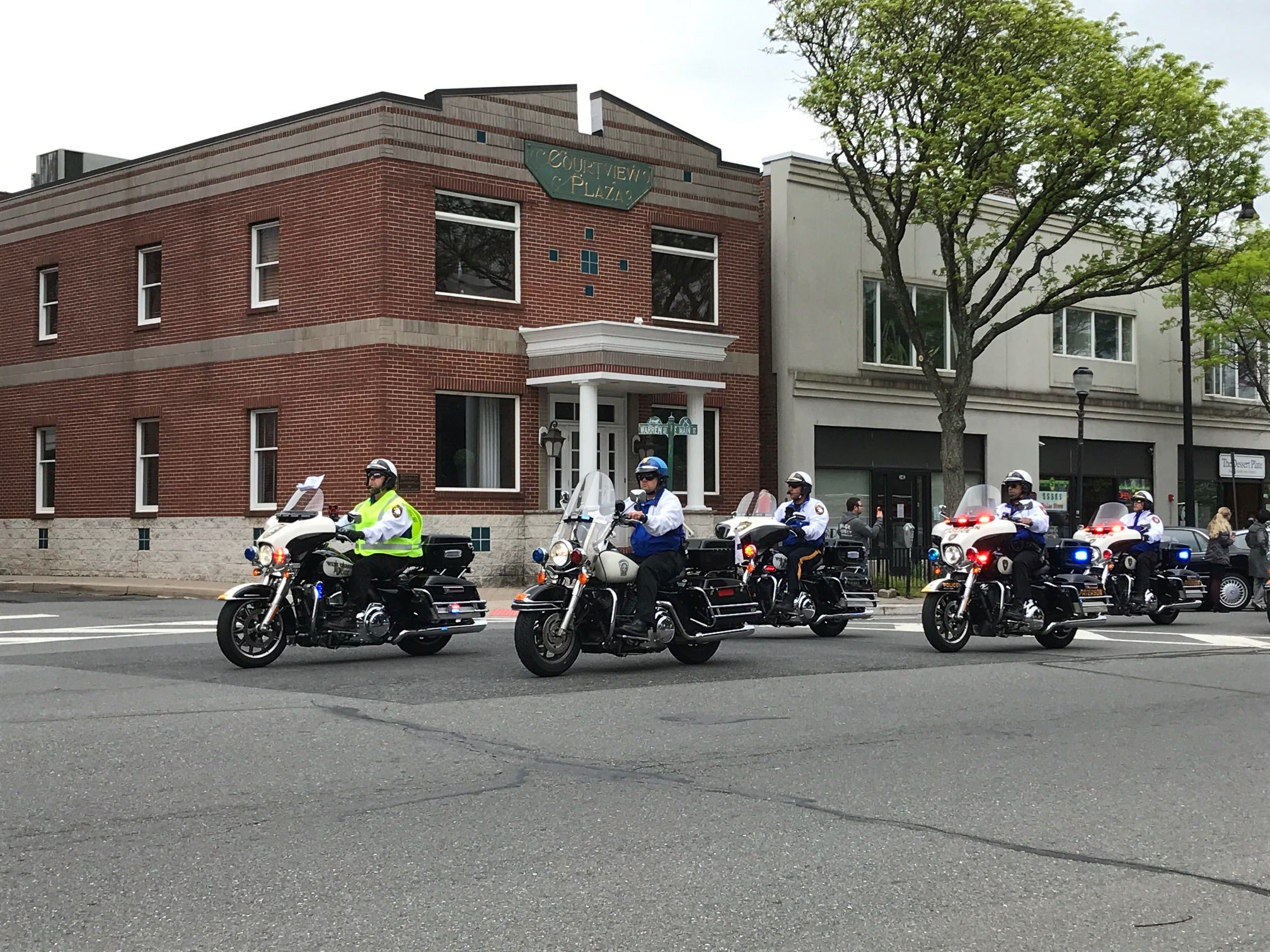 A group of  motorcycles escort riders from the Police Unity Tour into Somerville.