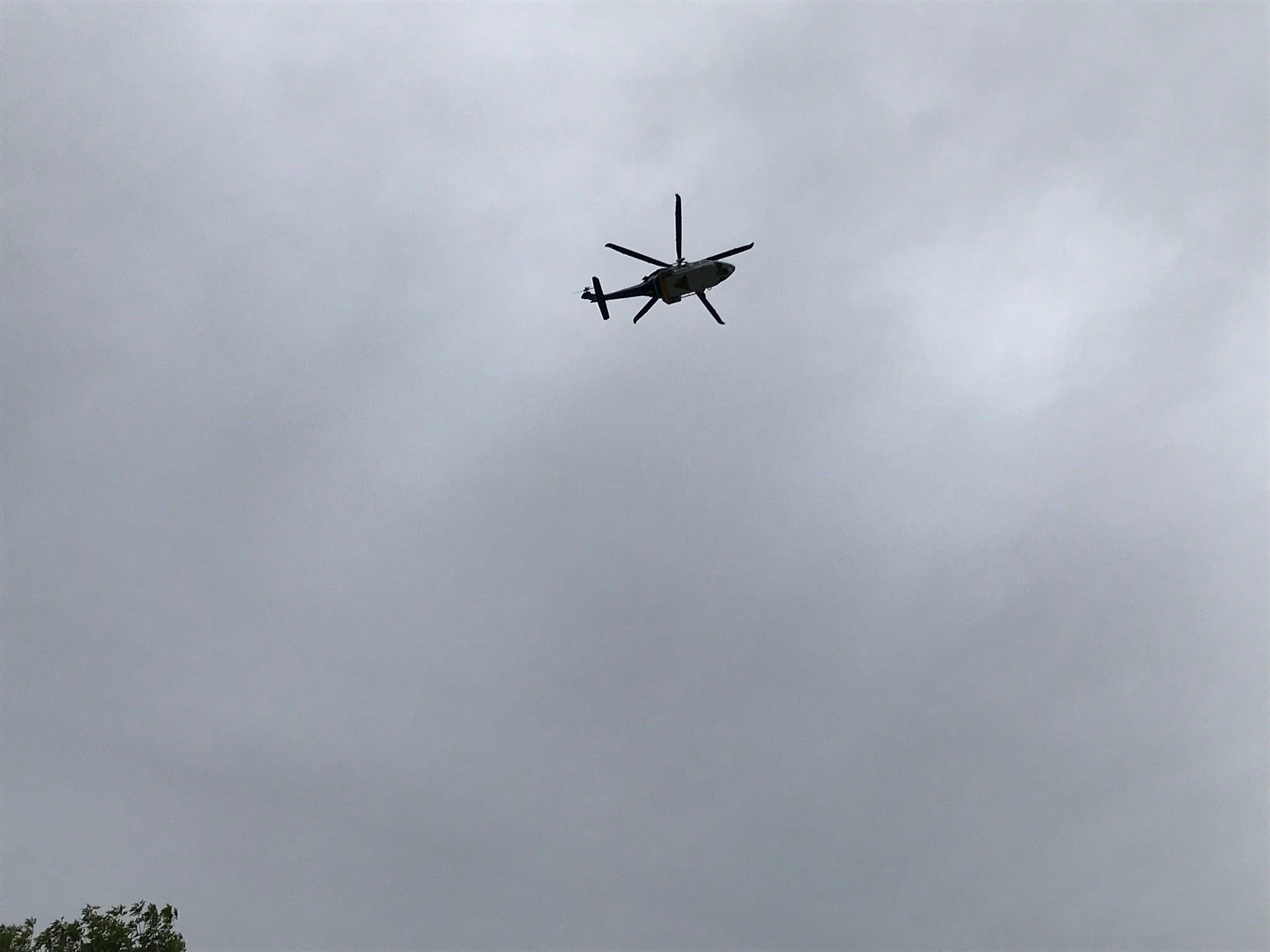 A New Jersey State Police helicopter was overhead as riders in the Police Unity Tour traveled through Somerville on Thursday.