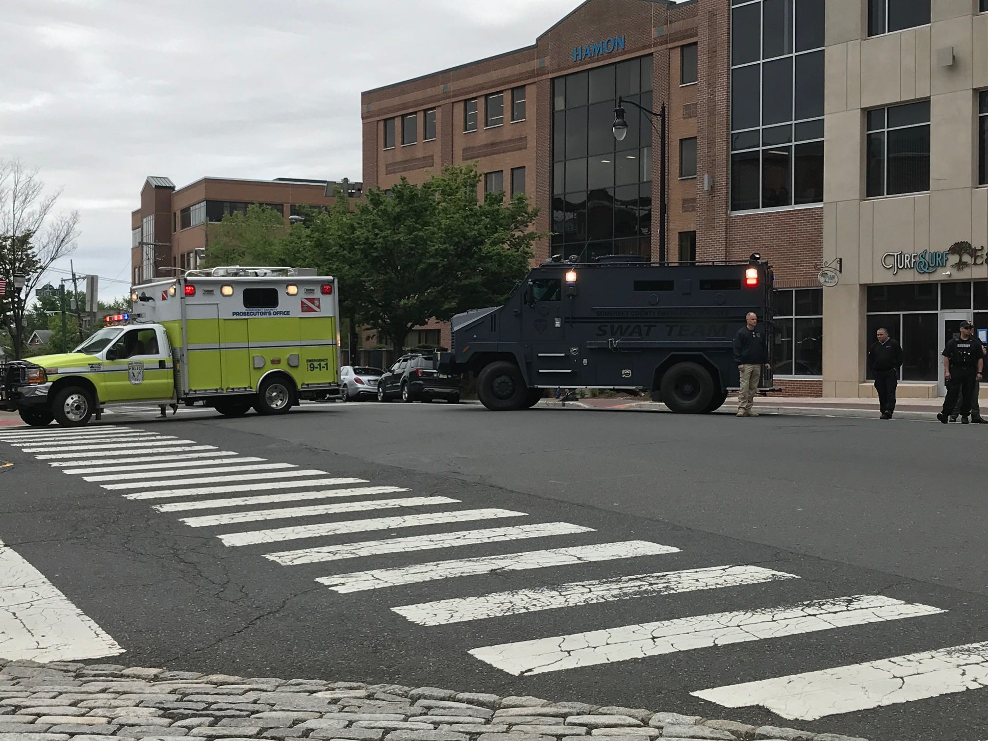 Emergency vehicles blocked off Main Street at Grove Street in Somerville for the safe passage of the riders participating in the Police Unity Tour.