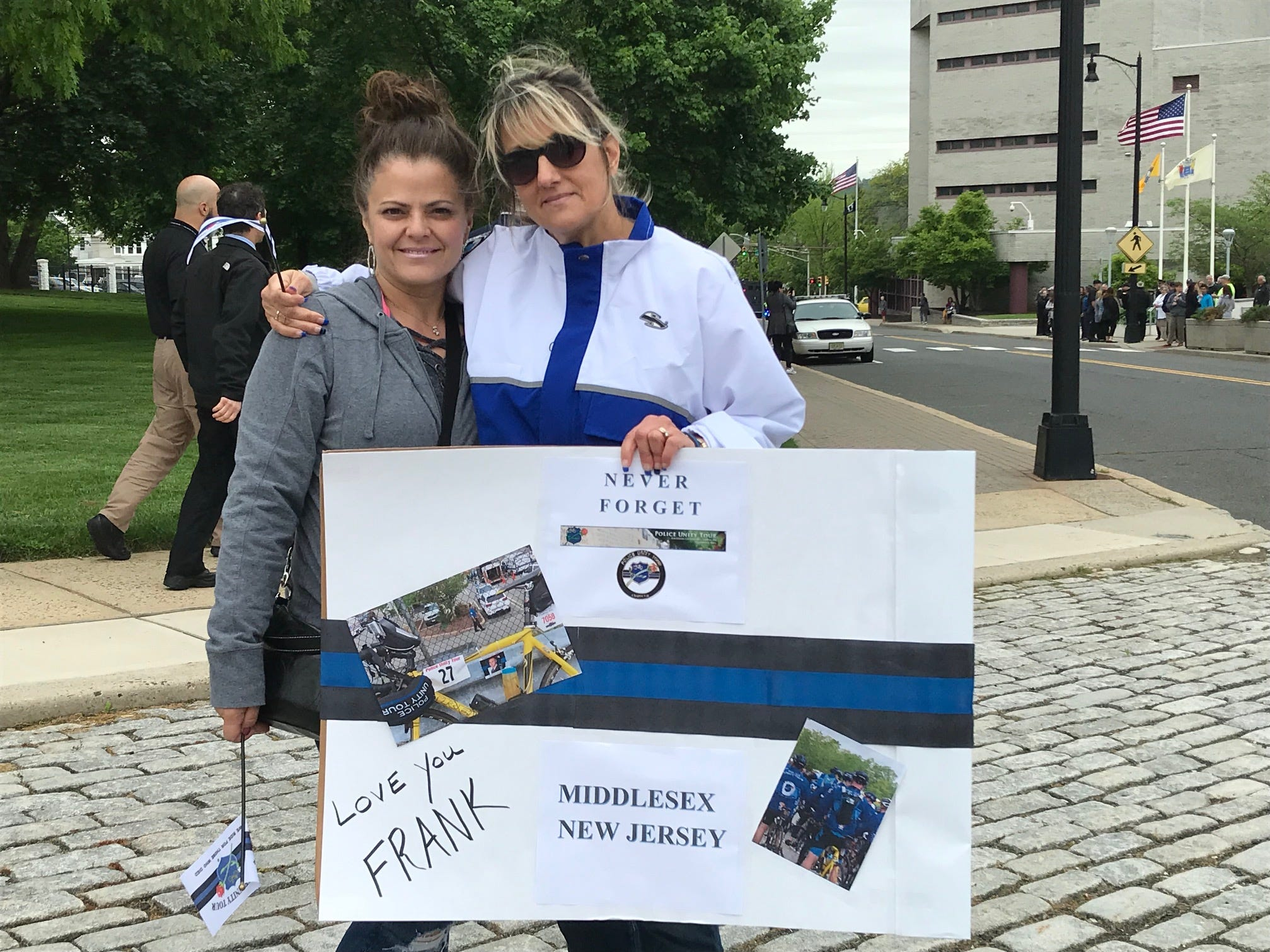 Yvonne Zazzara of Flemington and Jill DeNick, wife of Middlesex Borough Police Capt. Frank DeNick came out to cheer him on as the Police Unity Tour traveled through Somerville on Thursday.