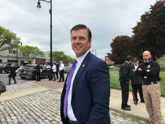 Somerset County Prosecutor Michael Robertson awaiting the arrival of the Police Unity Tour in Somerville.